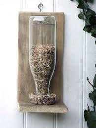 Resultado de imagen para jardin vertical con botellas recicladas