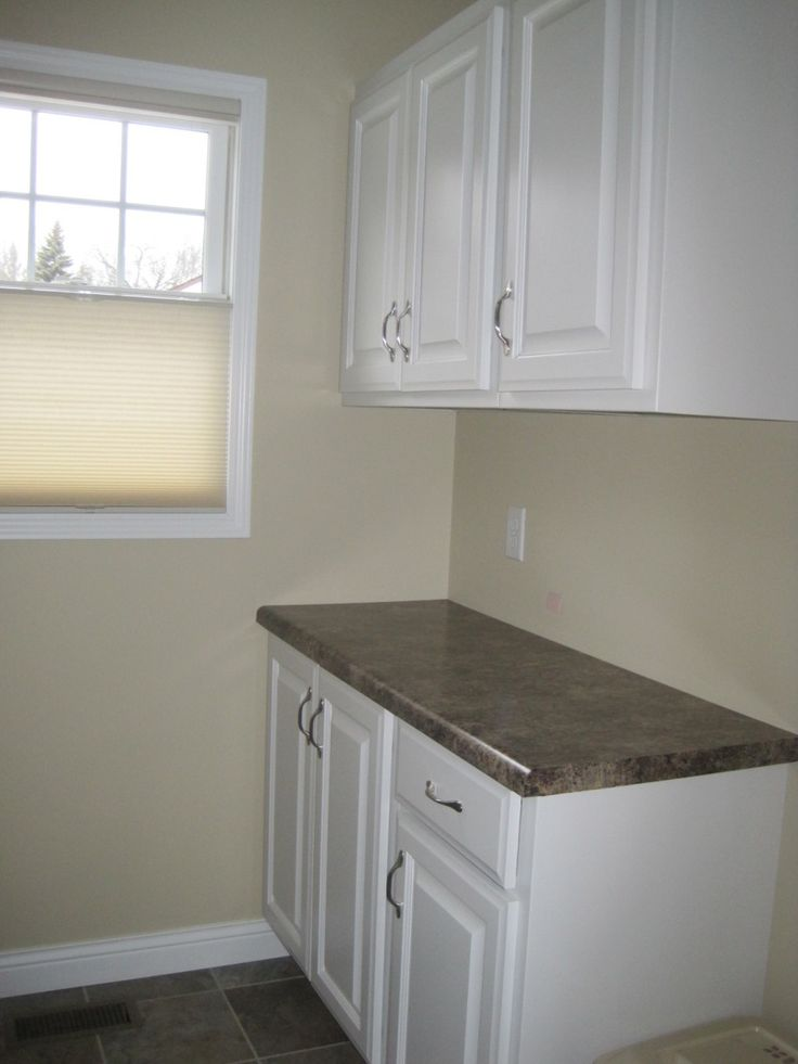 Furniture, Light Brown Color Paints For Small Laundry Room Wall Decor With Simple Modern Laundry Room Cabinets Ideas And Storage With Dark Countertops And Beige Roller Blinds: Laundry Room Cabinets ideas Design Interior