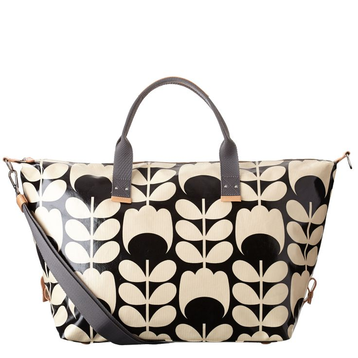 Orla Kiely: Shiny laminated weekend bag in 'Tulip Stem' print with Linear Stem cotton jacquard lining. Blue & Red colourway has a sand coloured lining, the Black & Cream style has an orange lining. The webbing tape handles are reinforced with natural vegetable tan leather. Inside details include a small zip pocket, key chain and mobile pocket. This bag has a zip