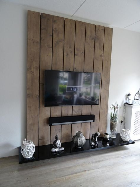Photo: TV wall unit made of scaffolding wooden boards and MDF. The boards are sanded smooth and put in the bark color wood stain and then painted …