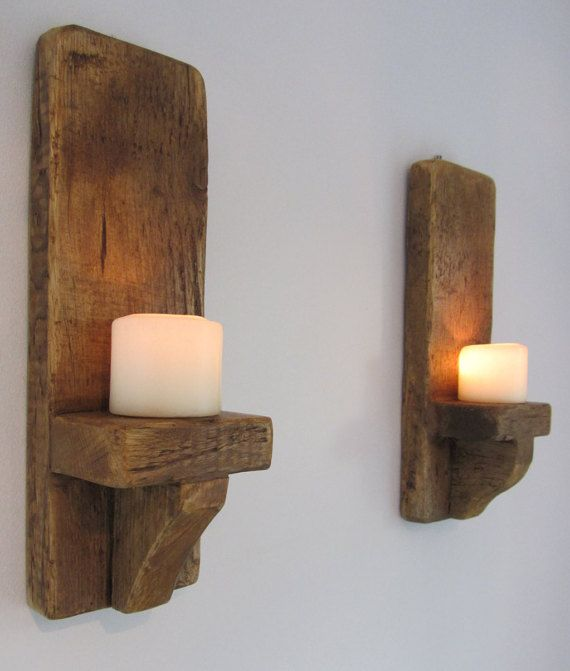 Pair of rustic wall sconce candle holders. Made from 32mm thick reclaimed planks & finished in brown beeswax. Each sconce measures approximately 11 cm wide x 12cm deep but can be made in different lengths. Suitable for holding led candles up to 3 inches thick (not supplied). These are handmade to order so please allow 5-8 working days for UK delivery , 8-12 for Europe , 10-15 for United states. Shipped worldwide via Hermes tracked.