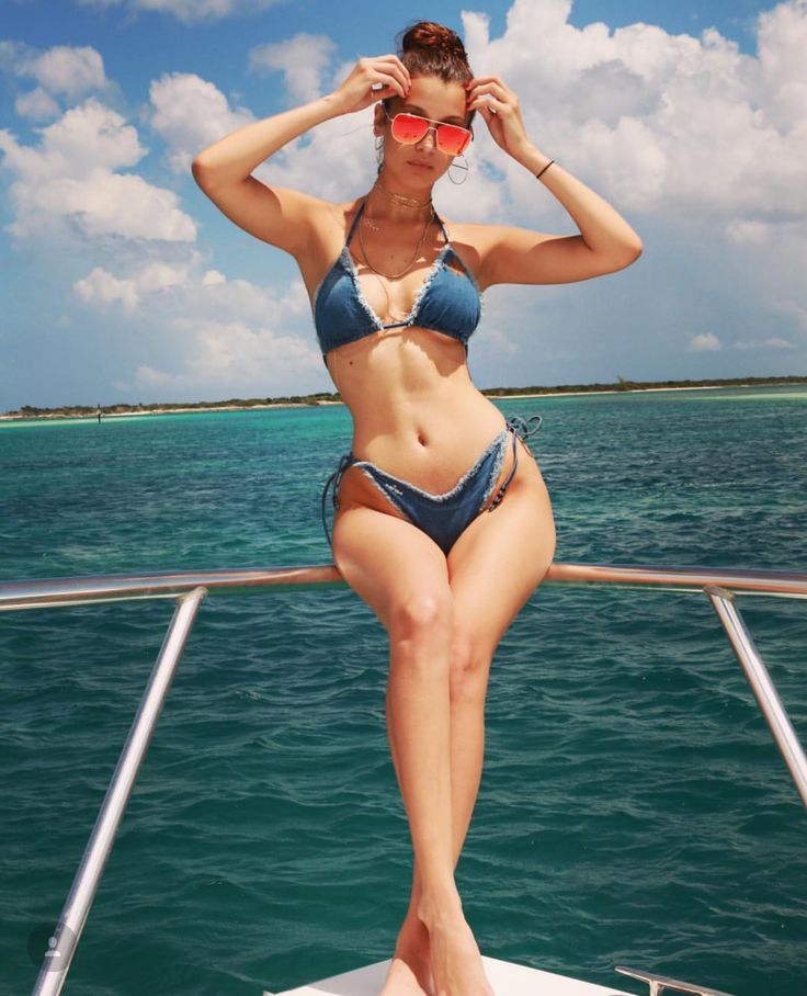 How to wear denim like Bella Hadid: The model wowed in a jeans bikini for a recent holiday. Check out the blog post to find out where to find a similar one.