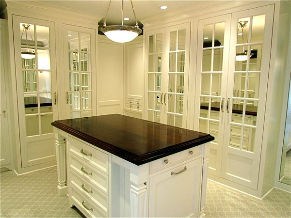 Elegant Walk In Closet Design With White Closet Island With Wood Countertop Floor To