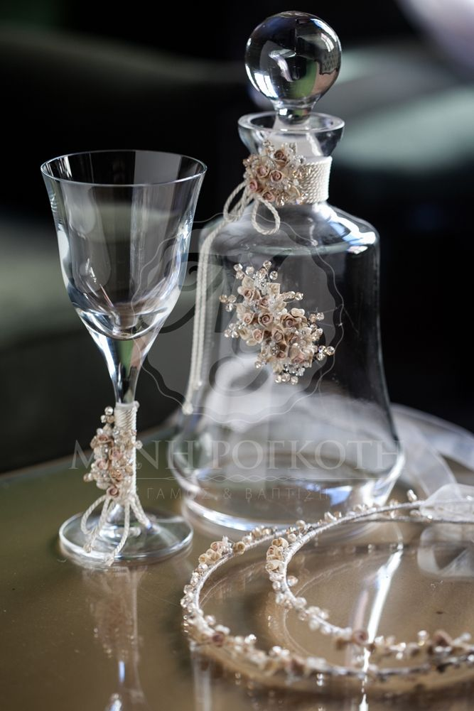 Handmade crowns from porcelain flowers, cystal wine glass and decanter with similar decoration.