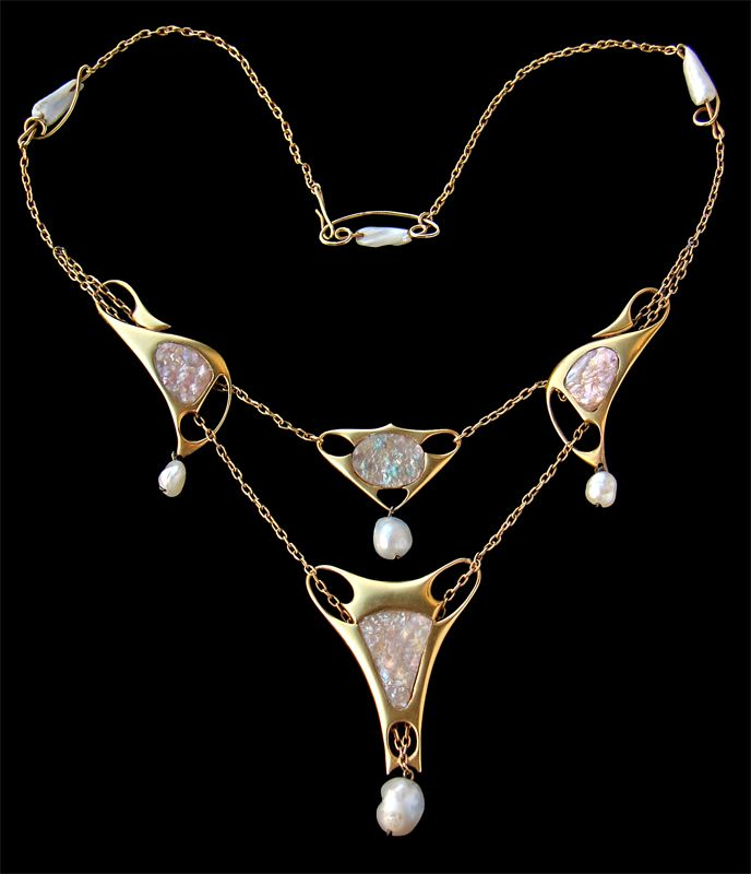 Archibald Knox 1864-1933  Liberty & Co Necklace - Gold Abalone Pearl  Pendant: H: 6.6 cm (2.6 in)  W: 9.4 cm (3.7 in)   Necklace: L: 36 cm (14.17 in)   British, 1900-04  Original Fitted Case  Original fitted case the silk marked:   Liberty & Co Ltd, Regent St, London  Literature: cf. Archibald Knox, Stephen A. Martin, 2001, page 251 & 252