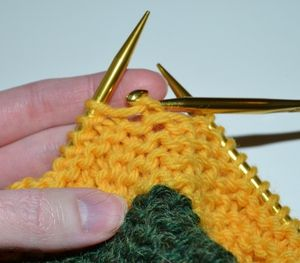 How to Fix a Dropped Stitch in Garter Stitch: Fixing a Dropped Stitch in a Knit Row