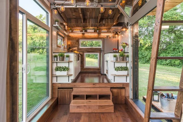 A lot of tiny houses look a bit like little dollhouses on wheels—peaked roof, petite double-hung windows, a tiny, almost vestigial porch. While these homes are, admittedly, adorable, it's always nice to see something a little different. Like the Alpha Tiny House, whose designers embraced a more modern aesthetic—and a seamless connection between indoors and out.