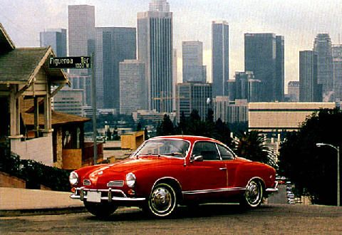 1969 Karmann Ghia by Volkswagen.  I am surprised that VW has not considered bringing an updated version of this model back.