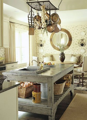 Country kitchen :: pot rack :: wallpapered kitchen :: mirror above table :: rustic kitchen island
