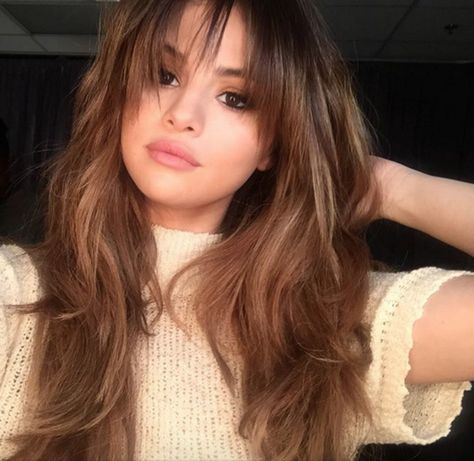 """Selena Gomez's recent chop had us eyeing our scissors. It's flattering on most, but especially so for heart-shaped faces, which are wide at the top and draw to a point at the chin. Reyman recommends a soft, crescent-shaped fringe (a.k.a. longer at the outer edges and slightly shorter in the middle). """"She was going for a '70s-inspired look,"""" explained Marissa Marino, the senior stylist at Nine Zero One Salon who cut Selena's bangs. """"She wanted them long and feathery, which is a trend right…"""