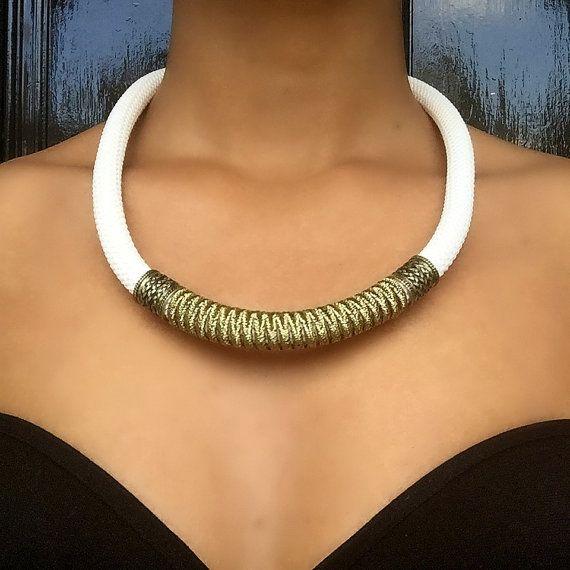 www.cewax.fr love this statement necklace ethno tendance, style ethnique, #Africanfashion, #ethnicjewelry - CéWax aussi fait des bijoux : http://www.alittlemarket.com/collier/fr_collier_plastron_multi_rang_ethnique_en_tissu_africain_beige_prune_jaune_-15921837.html -  Ce collier est unique, classe, et élégant. Il peut se porter en toute occasion.  - Fait main  - Réalisé sur commande - Matériaux : corde