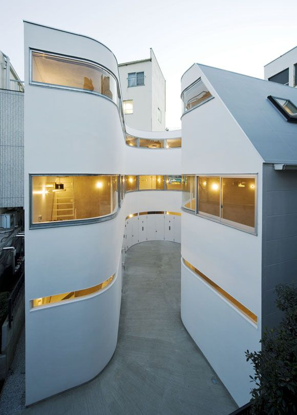 Townhouses in Japan for the motorcycle lover. Ride your motorcycle right in... and proceed upstairs to your living quarters.