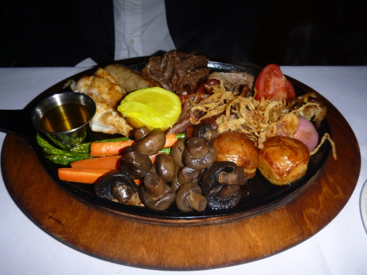 Just ONE plate of food from the Mixed Grill for two at the Bahamian Club at The Atlantis Resort on Paradise Island, Nassau, Bahamas