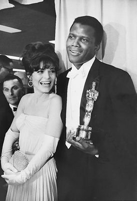 Sidney Poitier, who was the first black actor to win an Oscar for Best Actor for 1963′s Lillies Of The Field - Alongside Anne Bancroft, who presented him the Oscar that night.