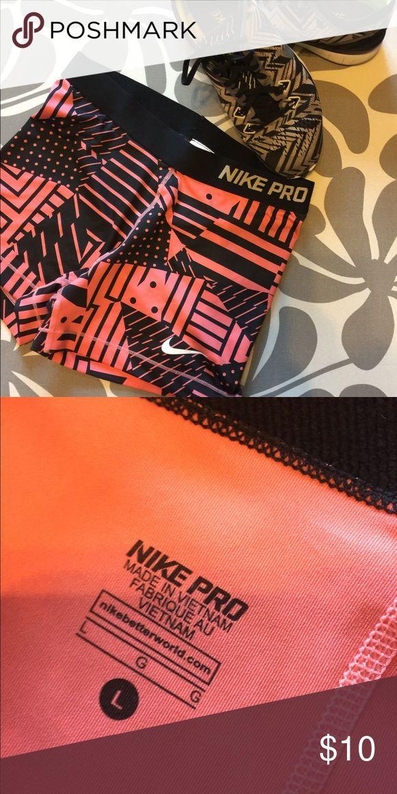 Nike pro women's training shorts Women's Nike pro training shirts, size large , coral and black graphic pattern, worn once. Nike Shorts