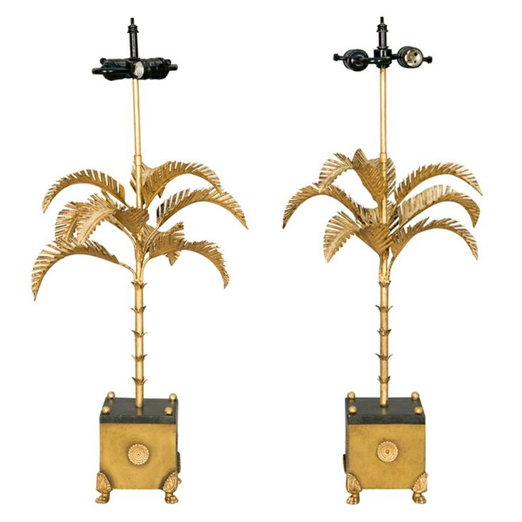 Pair of Painted and Gilded Tole Palm Tree Lamps    Mid-century  Pair of gilded tole palm tree lamps, each raised on square base raised on paw feet.