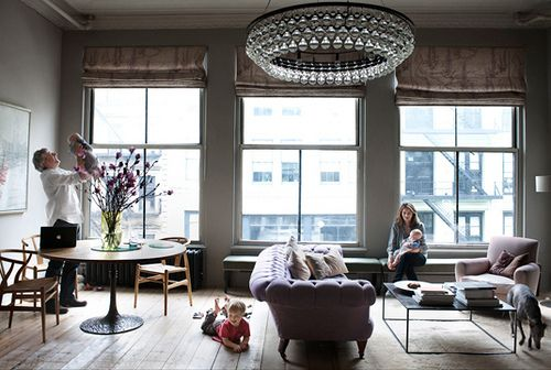 Chandelier, windows, tufted couch