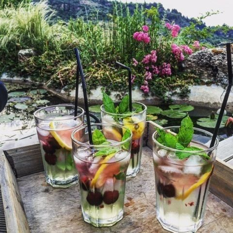 Mint leaves and 3-4 crushed cherries at the bottom of the glass along with some elderberry flower syrup, lots of ice, some tsipouro, a slice of lemon and topped off with some soda. This cocktail will bring with it the freshness of spring no matter what season you make it…