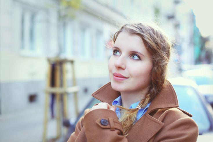 Brown coat, blue shirt
