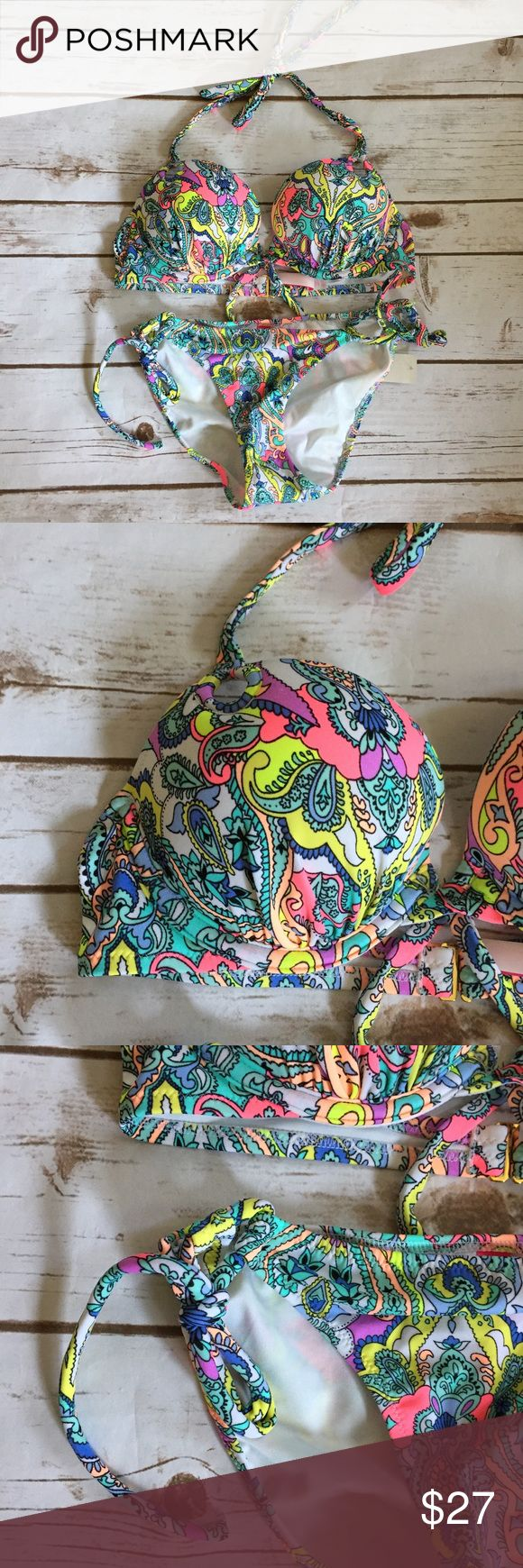 NWT Victoria's Secret Paisley Cut Out Bikini SMALL NWT Victoria's Secret Paisley Cut Out Bikini 32A Top SMALL Bottoms Size: 32A Top SMALL Bottoms Clasps in back and ties behind neck  Underwire  Padded  Nylon blend  Hand wash    /305/ Victoria's Secret Swim Bikinis