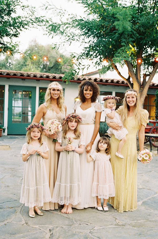 Bride's side of the bridal party looking straight out of a dream. Love the choices for dress and hair.  seen on ruffledblog.com