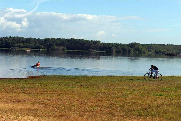 Camping Aurilandes in Aquitaine, south west France.  Beautiful setting on the shores of Lake Aureilhan with miles of cycle paths, perfect for getting on your bikes and take a picnic to the lake's shores.
