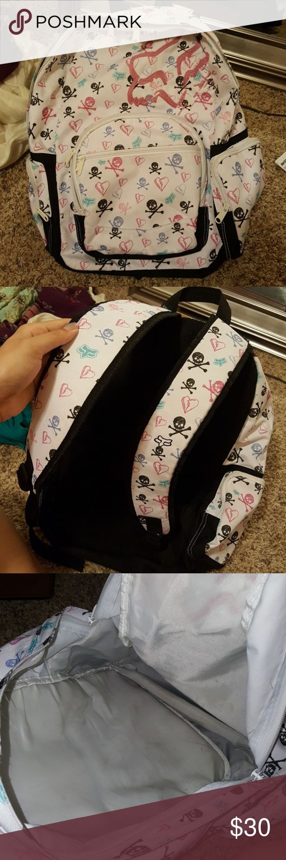 Large backpack Very good condition! Cleaned out my old room back at my parents house and found this backpack that I vividly remember using just for my 8th grade year! It was my Avril Levigne phase that ended quickly and I never used it again. I paid 75 dollars of my summer job money to buy this! I just cleaned it too! Great for kids! Fox Bags Backpacks