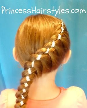 Twist braid with ribbon.  WOW this site has SO many amazing hairstyle ideas!