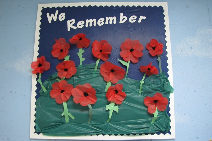 Tissue paper poppies - 4 tissue paper hearts, construction paper stems, pom-pom centres Plastic table clothes used for bulletin board background