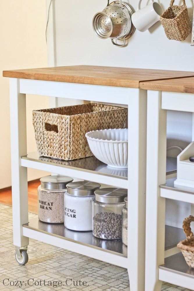 white bottom, wood top. baskets and staples storage. maybe do this with the Bekvam. paint it white.