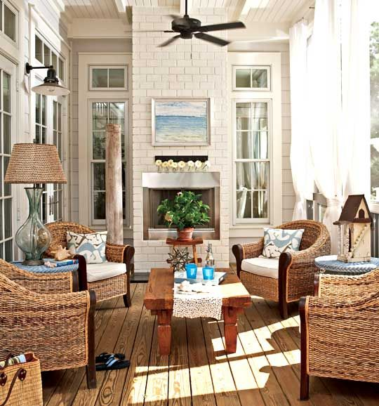 Interior design by Georgia Carlee of GCI Design in Florida.: White walls, seagrass seating, aqua/teal accents with wood tables.