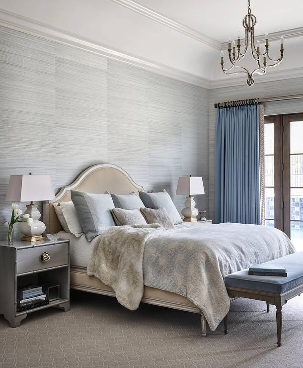 gray and blue bedroom features walls clad in gray