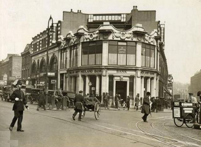 Camden Town in the 1920's Here's a great pic of Camden Town tube station taken in 1927 with the road layout much as it was until the 1960's when the one-way systems were introduced in many parts of London and featuring tram tracks, period cars and a couple of hand carts - plus a copper