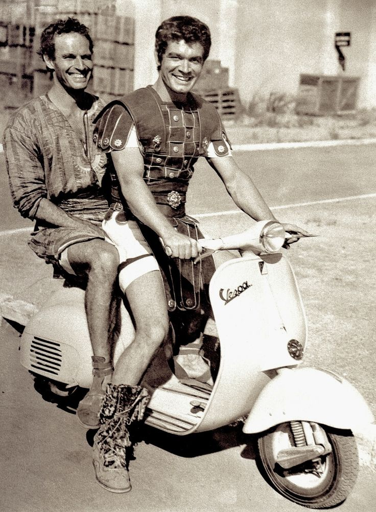 Boys just wanna have fun. CHARLTON HESTON & STEPEN BOYD on a VESPA in between filming the sword & sandal classic epic BEN HUR in Rome, Lazio, Italy (1959) La Dolce Vita : The Golden Age of Italian Style & Celebrrity by Stephen Bayley. #charltonheston #stephenboyd #vespa #benhur