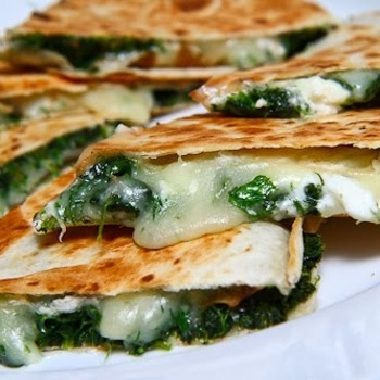 Quesadillas inspired by the flavours of spanakopita, Greek spinach pie with spinach, fresh herbs, feta and plenty of melted cheese.