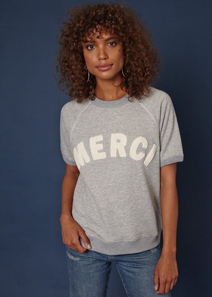 INFO Merci Cara is the same classic inspired short sleeve sweatshirt we all already love! We added chenille patch letters to say Merci in white letters on a lig