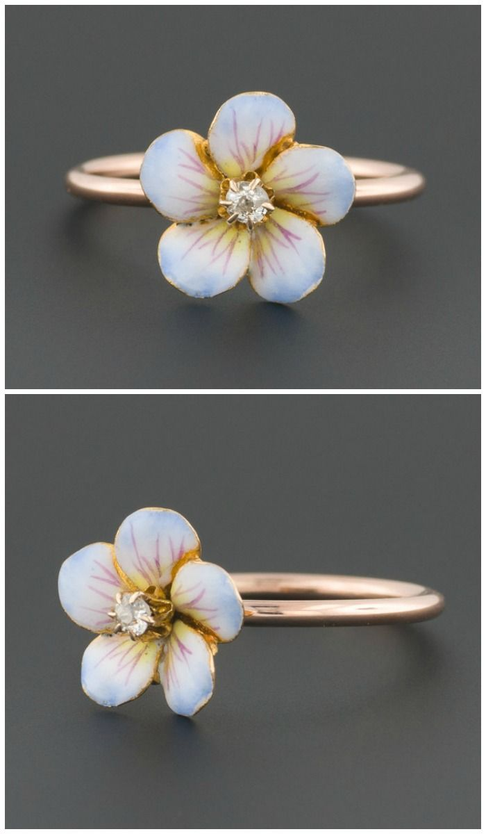 A ring made from a converted antique pin. The flower is enamel, with a diamond center.