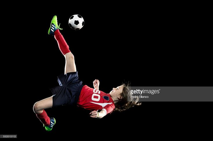 Young female soccer player in action scissor kick.