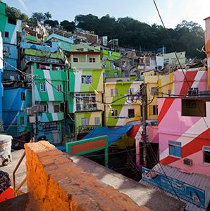 The word pretty isn't often associated with the shantytowns of Rio de Janeiro. But gazing across the hills toward the notorious Santa Maria favela, you might be pleasantly surprised by the burst of colors—the result of a recent social art project launched by Dutch design duo Haas.
