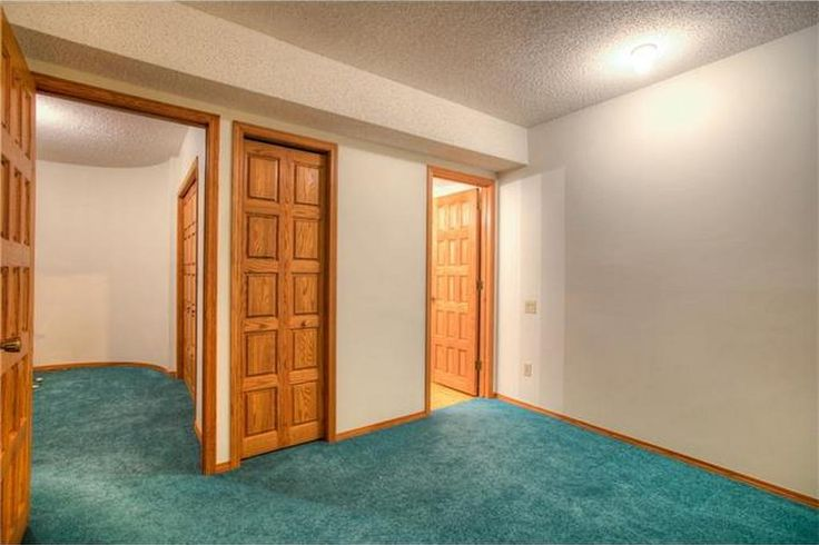 """Bed room of the guest suite, looking into the sitting room.  """"Flex Rooms"""" indeed."""