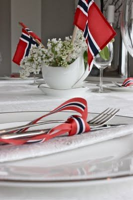 This is so pretty with the Norwegian ribbon around the silverware.