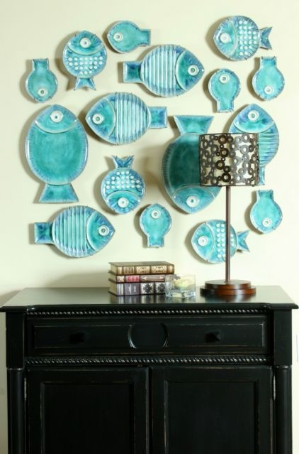 Pick a theme and play with it. Grouping similar plates in a variety of sizes makes for an eye-catching montage. Or, if you have plates of different colors and designs, pick similar-size ones to hang together for a more ordered but visually interesting look.