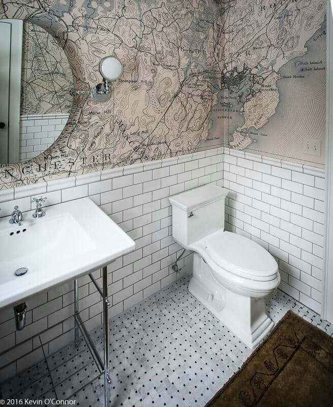 Updated traditional bath, maps of area as wallpaper. Basketweave marble tile floor subway tile copyright Kevin O'Connor - This Old House project