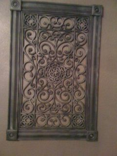 Wall art created from a rubber mat.  We framed it, painted the frame black and faux finished it all over.