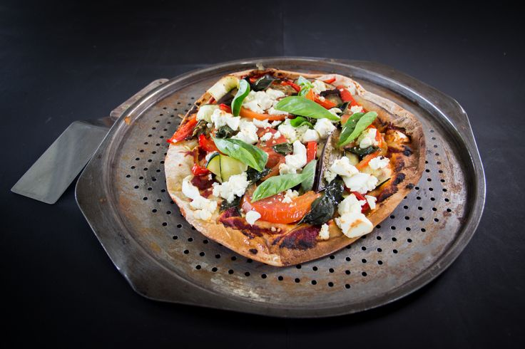Vegetarian Pizza Topped with Fresh Basil