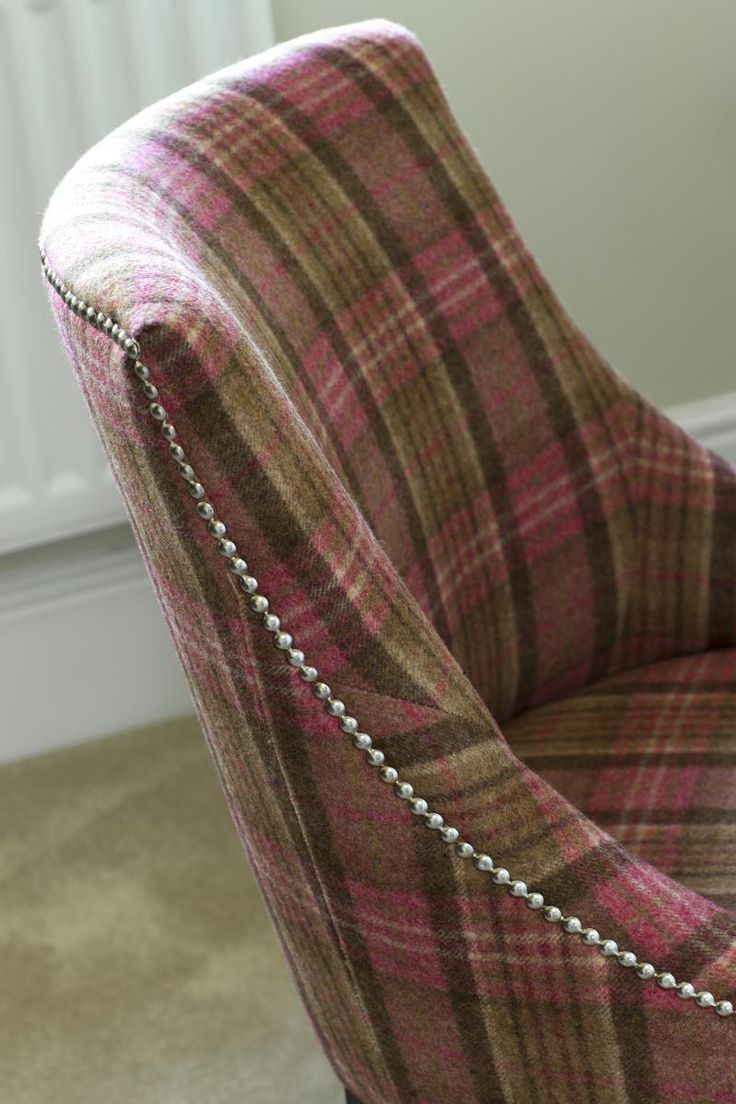 Splashes of raspberry will inject colour into a room. We love this tartan fabric chair. #fabrics #featurechair #interiors