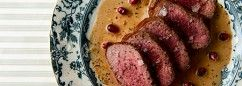A recipe for venison backstrap or medallions seared medium and served with a Belgian sauce with gin, juniper and sour cream.