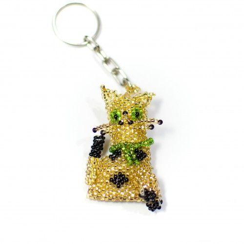 #Nyckelring: #katt i #guld - #handgjord av mängder av små glänsande plastpärlor i Guatemala. 80:-