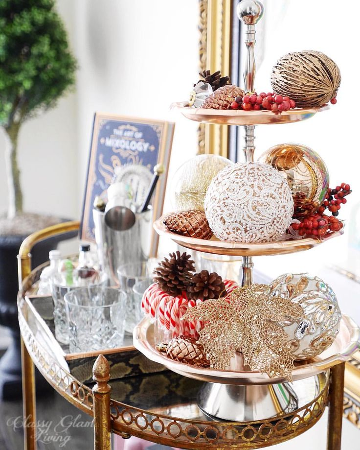 Christmas bar cart styling. Ornaments. Copper tiered tray. Dining room decor.