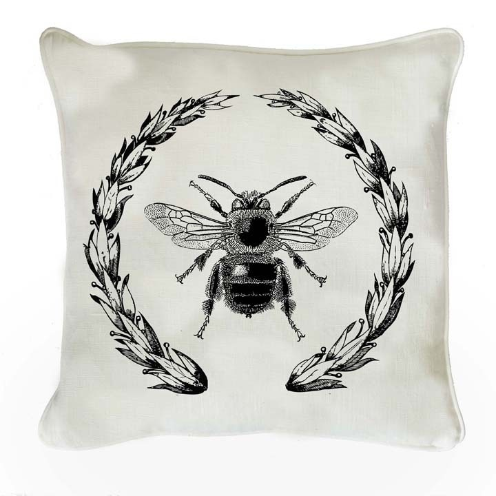 Bee Wreath Cushion - This beautiful pure linen cushion from our Napoleon range features our trademark illustrations from encyclopediae of natural history - this time with the Napoleonic bee enclosed in an imperial wreath. Available in white or natural linen, each cushion is piped, has a concealed zip and a custom-made feather inner. Made in England. Size: 45cm x 45cm